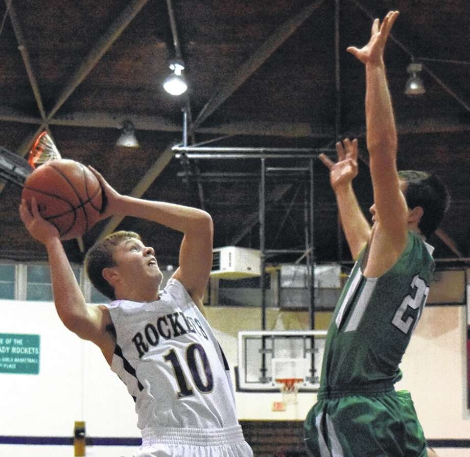 Routt's Dylan Marshall goes up for a shot as Carrollton's Jeremy Watson defends during a basketball game at the Routt Dome in Jacksonville Thursday. Photo: Rob Evans | Journal-Courier