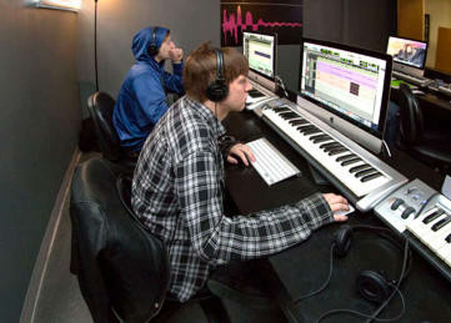 Students work in the music production lab at Lewis and Clark Community College, located in the basement of the Benjamin Godfrey Memorial Chapel. Photo: For The Telegraph
