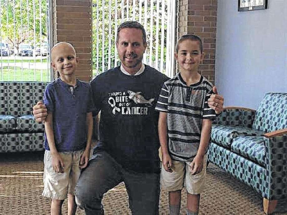 Jonny (left) and Jacky Wade share a visit with Congressman Rodney Davis (center). Jonny Wade lost his battle with cancer on Christmas Eve, but Davis is asking other congressmen to wear a wristband in the boy's honor during the State of the Union address. Photo: Photo Courtesy Of Rodney Davis