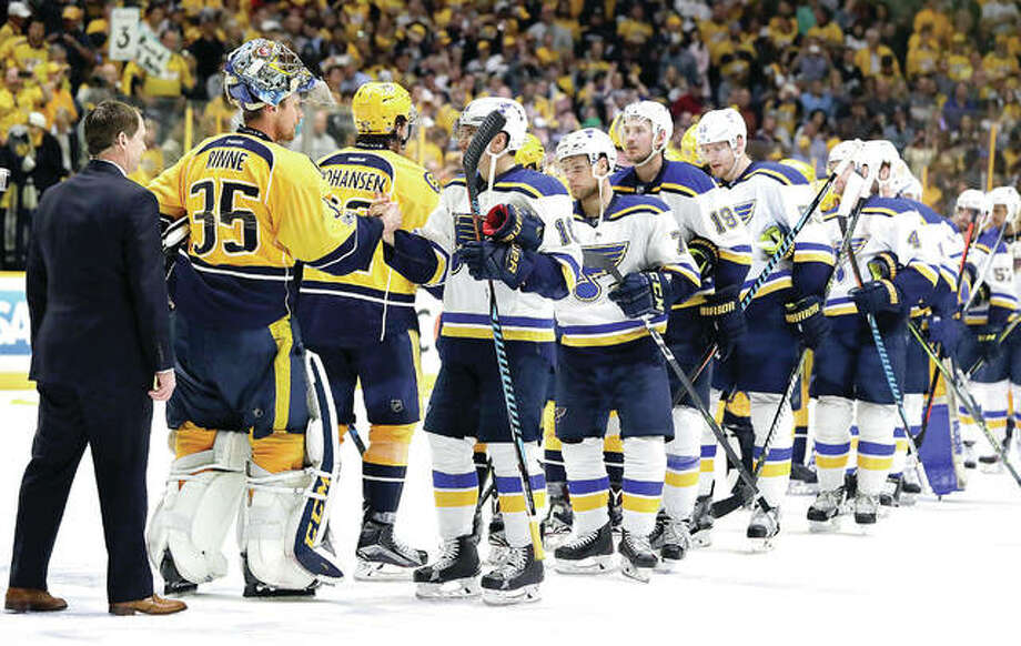 The Blues and the Nashville Predators players shake hands following Game 6 of their Stanley Cup Western Conference semifinal series in Nashville. Photo: AP
