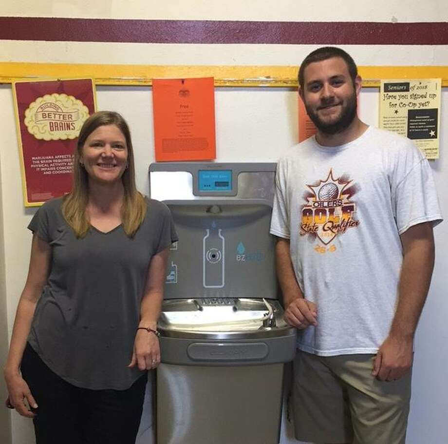 East Alton-Wood River High Green School Coordinator Sarah Jones and EAWR senior Brenden Allen pose with one of their water bottle filling stations, newly installed at EAWR Thursday. Photo: For The Telegraph