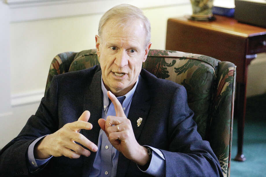 Illinois Gov. Bruce Rauner talks Monday to the Associated Press at the Executive Mansion in Springfield, discussing the year behind and the year ahead for Illinios on the eve of the one-year anniversary of his taking office. Photo: Seth Perlman | Associated Press