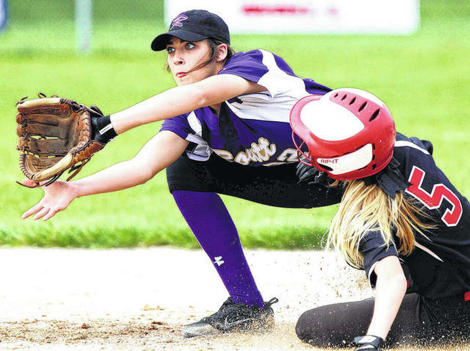 Jacksonville Routt's Bella Powell (left) waits for the throw as Calhoun's Junie Zirkelbach slides safely into second with a stolen base during the Warriors' nonconference softball victory Thursday in Jacksonville. Photo: Dennis Mathes / Journal-Courier