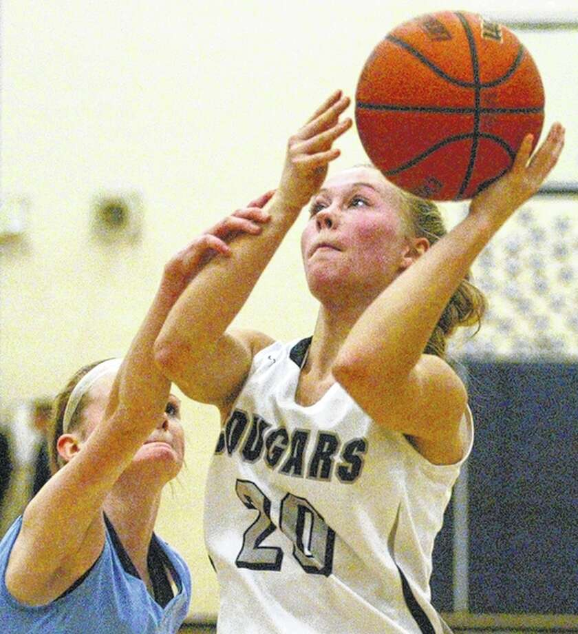 West Central's Maddie Lashmett is fouled by Triopia's Brooke Walker during a game at the North Greene Lady Spartan Classic in White Hall Monday. Photo: Dennis Mathes | Journal-Courier