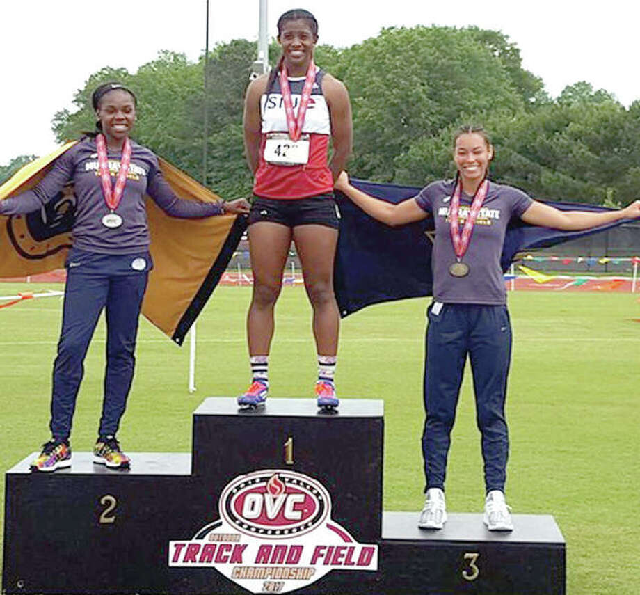 SIUE's Lauren White, center, stands atop the awards stand after winning the heptahlon at the Ohio Valley Conference Championships Friday in Oxford, Alabama.