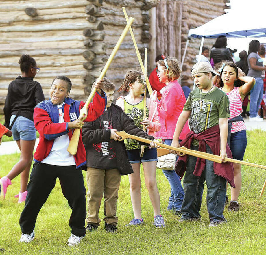 Students from Alton's East Elementary School learned a close order drilling at the event after they got over the excitement of being handed wooden toy muskets to use for their marching. Photo: John Badman | The Telegraph