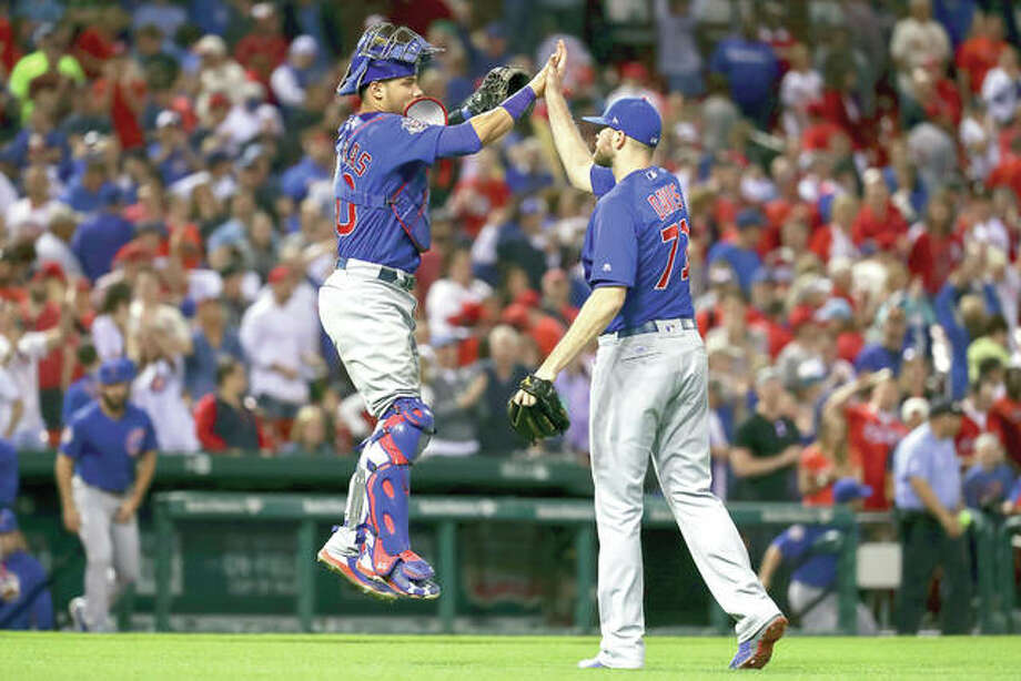 Chicago Cubs catcher Willson Contreras, left, celebrates with Wade Davis, right, after beating the Cardinals 3-2 Friday at Busch Stadium. Photo: AP