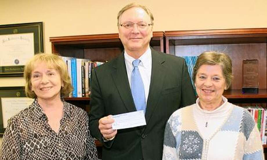Photo provided Diana Olinger (left), president of the Passavant Area Hospital Auxiliary, and Charlotte Hubbard (right), auxiliary treasurer, present Passavant President Doug Rahn a check for $50,000.