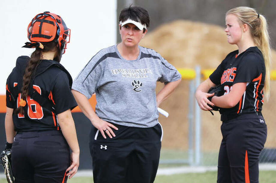 Edwardsville coach Lori Blade (middle) meets with catcher Taryn Brown (left) and pitcher Jordan Garella in the pitcher's circle during a break in the Tigers' victory March 20 in Gillespie. Photo: Billy Hurst / For The Telegraph