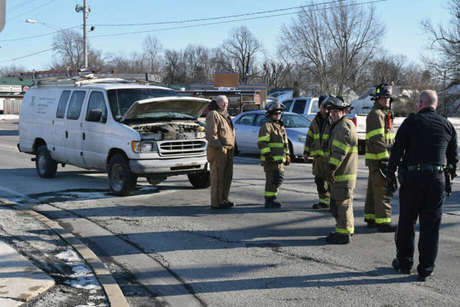 Jacksonville Firefighters and South Jacksonville Police respond to a car fire around 2:15 p.m. Wednesday on Morton Avenue and Main Street. Firefighters reported that the fire was out by the time they arrived on scene and the vehicle, owned by Harold Cook of Jacksonville, seemed to sustain little to no damage. Photo: Nick Draper | Journal-Courier