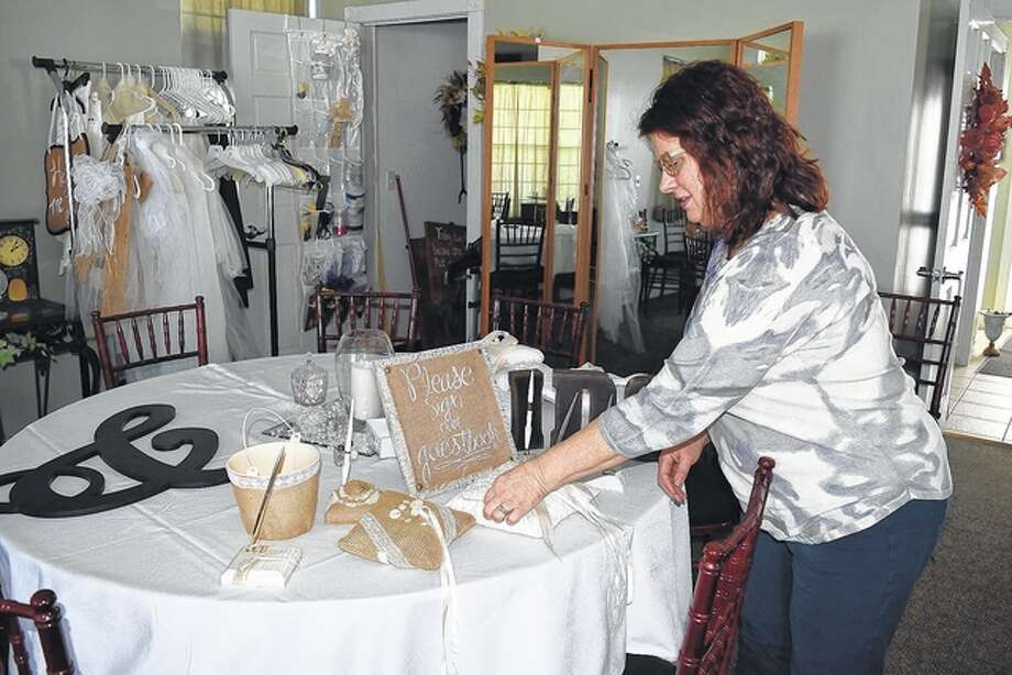Buena Vista Farms' wedding planner and owner Teri Gutierrez arranges wedding ceremony items Wednesday in The Lodge at Buena Vista Farms northwest of Jacksonville. Photo: Greg Olson | Journal-Courier