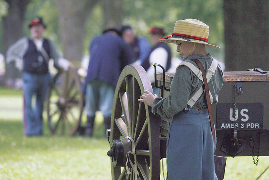Journal-Courier file A young Civil War re-enactor participates in a recent General Grierson Days battle re-enactment in Jacksonville's Community Park. Organizers of the event announced Thursday that because ofdue to declining support, they were canceling the annual summertime attraction.