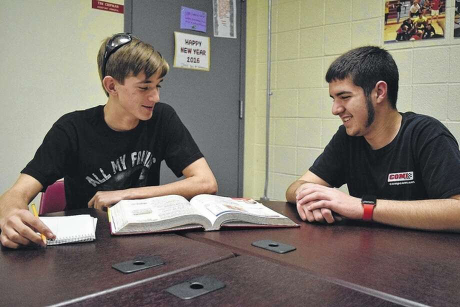 Nick Rentschler of Jacksonville helps Andrew Sipes of Jacksonville with homework, one of the things students can do during The Great Kindness Challege. Photo: Nick Draper | Journal-Courier