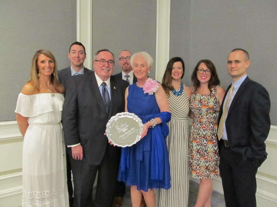 Margaret Hopkins of Alton received a 2017 Woman of Achievement Award on Tuesday, including an engraved silver platter, at the annual luncheon at the Ritz-Carlton Hotel in Clayton, Missouri. Hopkins is shown with her husband John, and family.