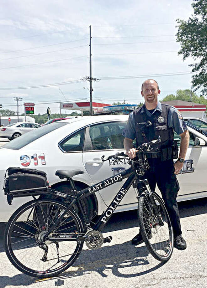 East Alton Police Sgt. Michael McCormick with the department's new bike, which was recently donated by Madison County Transit.