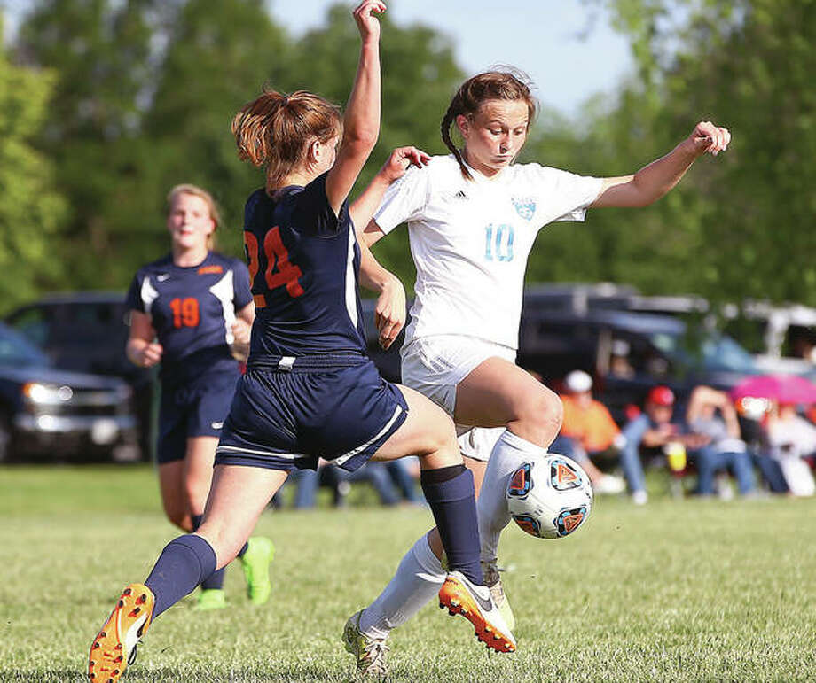 Carlinville's Lexi Egelhoff, right, and her Carlinville teammates dropped a 1-0 decision to Pleasant Plains in the semifinals of the Quincy Notre Dame Class 1A Sectional Tournament Tuesday night in Quincy. Photo: Billy Hurst | For The Telegraph