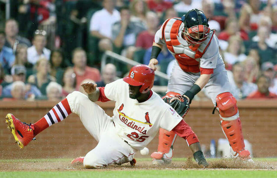 The Cardinals' Dexter Fowler scores as Red Sox catcher Xander Bogaerts is unable to catch the throw during the third inning Tuesday night at Busch Stadium. Photo: AP