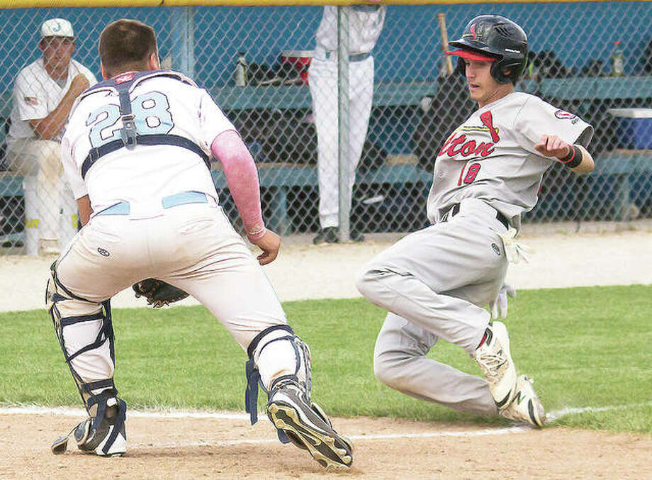 Alton's Charlie Erler slides into home as Jersey catcher Collin Carey waits to make a tag. Photo: Nathan Woodside | For The Telegraph