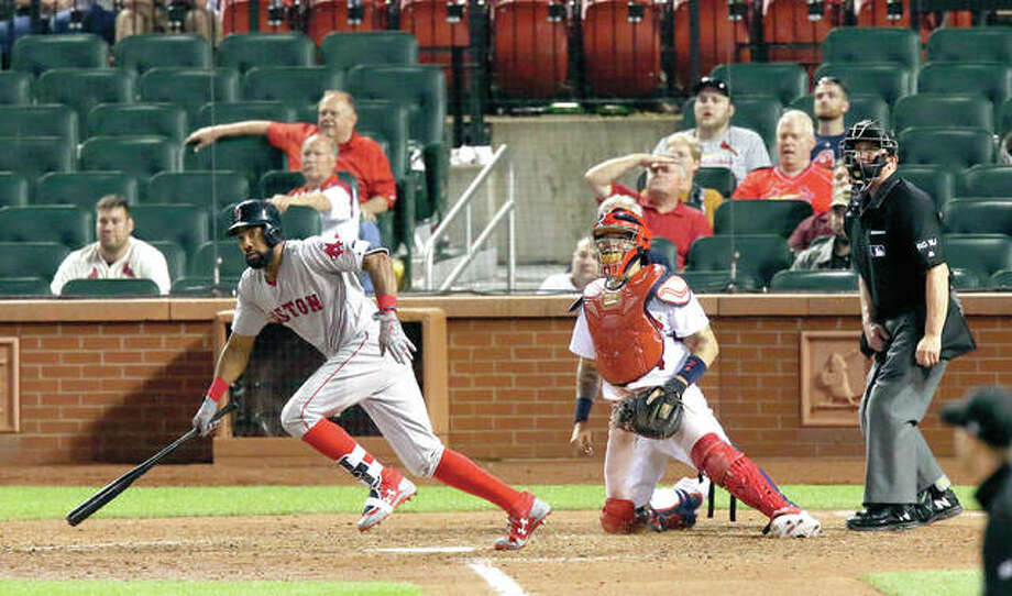 Boston's Chris Young drives in the go-ahead run with a single in the 13th inning against the Cardinals Wednesday night at Busch Stadium. Photo: AP