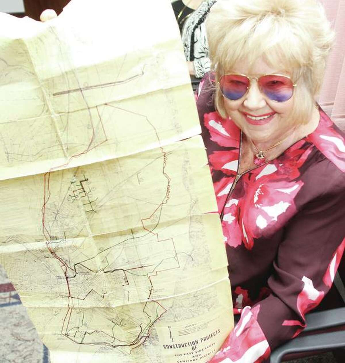 Madison County Board Member Helen Hawkins, D-Granite City, holds an old project map for the East Side Levee and Sanitary District. Hawkins was one of three new appointees to the Metro East Sanitary District board at Wednesday's County Board meeting. Hawkins has been fighting flooding issues since moving to the area in 1964, and played a part in the creation of the MESD, which replaced the East Side Levee District in the early 1970s.