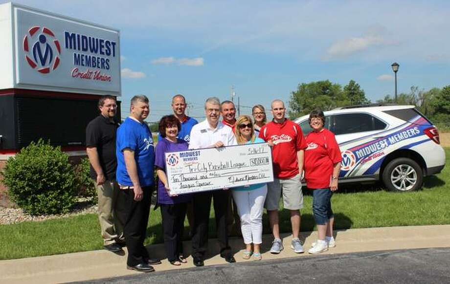 Bethalto, East Alton, Roxana and Wood River representatives accepted a $10,000 check donation from Midwest Members Credit Union, 101 Wesley Drive, for Riverbend's Tri-City Baseball/Softball League Tuesday morning. Photo: For The Telegraph
