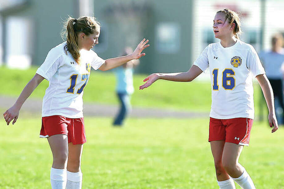 Roxana's Emma Lucas, right, and Haley Milazzo will return next season for the Roxana after helping the Shells to their best girls soccer season this year. Lucas has 29 goals and 11 assists and Milazzo nine goals and sevens assists for the 14-3 Shells. They are shown during a 2016 game. Photo: Telegraph File Photo
