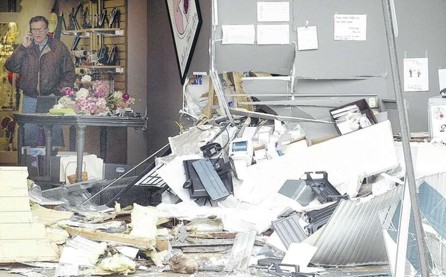 The impact of an accident in which a van drove into Girls in White Satin Bridal and Formalwear left debris scattered in the business' office/workspace. Photo: Nick Draper | Journal-Courier