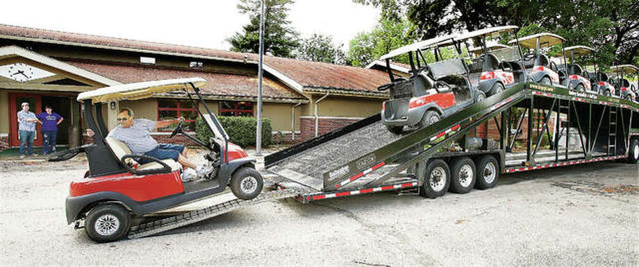 The driver of a semi-truck delivering golf carts unloads them Friday at the clubhouse of Golf at Lockhaven, recently rebranded from the former Lockhaven Golf Club by a new company. Photo: John Badman|The Telegraph