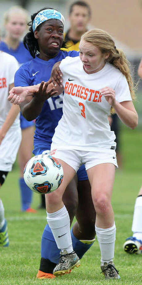 Marquette's Ketoura Ngwa, left, and Rochester's Katie Cochran battle for the ball during action in Friday's championship game of the Class 2A Jacksonville Regional at Alumni Field in Jacksonville. Rochester won 3-2.