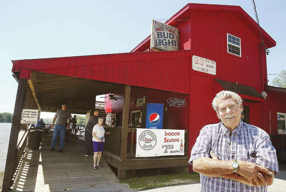 Oliver Ready, co-owner of O'Jan's Hot Fish on Main Street in Grafton, stands in front of the bright red building that has been in business for 50 years. Photo: John Badman|The Telegraph