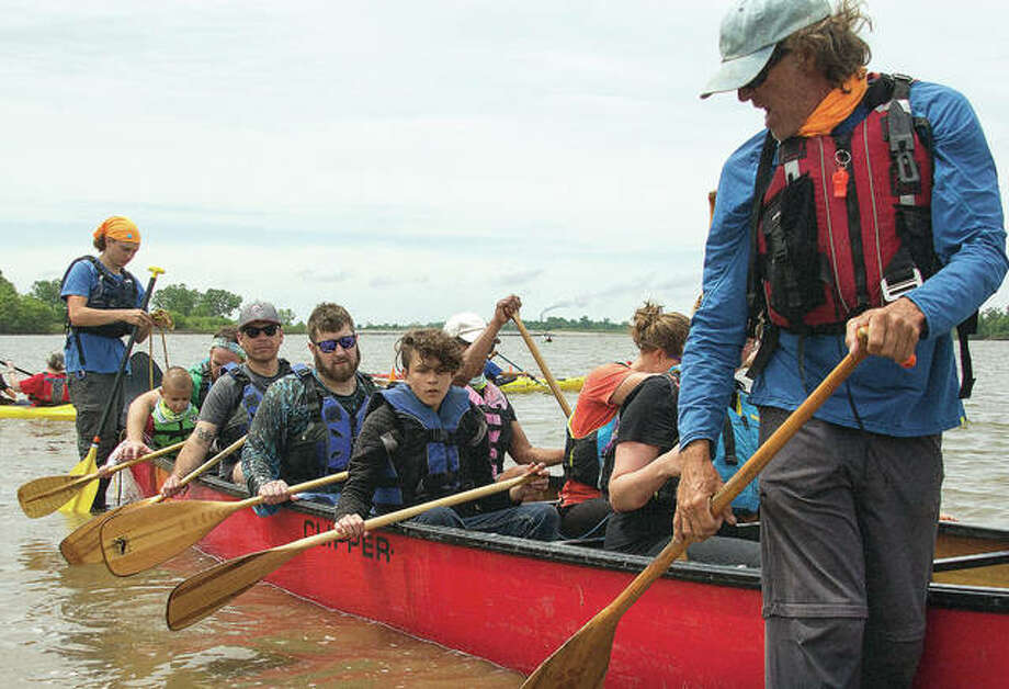 "Mike ""Big Muddy"" Clark instructs a group of canoeists on tandem rowing Saturday during the 10th annual Paddle Festival held at Riverlands Wild Bird Sanctuary in West Alton, Missouri. More than 100 showed up to test out several different modes of Mississippi travel, including paddle boarding. Photo: Photos By Nathan Woodside 