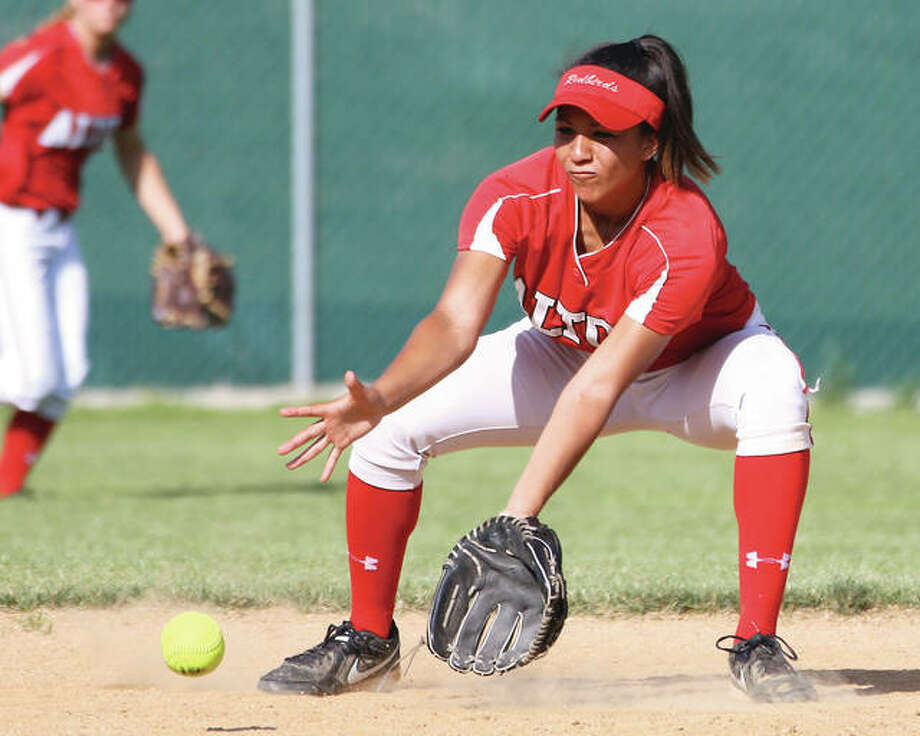 Alton's Savannah Fisher fields a groundball during Thursday's Southwestern Conference game against Edwardsville at Alton High in Godfrey. The senior shortstop is wrapping up a productive career as an All-SWC performer for the Redbirds and plans to walk-on with Illini softball and Illinois. Photo: Billy Hurst / For The Telegraph