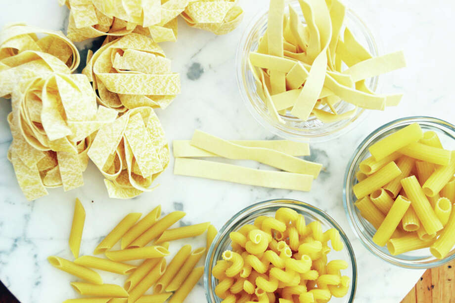 An array of dried pastas can be turned into easy weeknight pasta dinners. They include egg noodles (clockwise from top), ziti, cavatappi , penne and pappardelle. Photo: Matthew Mead | Associated Press