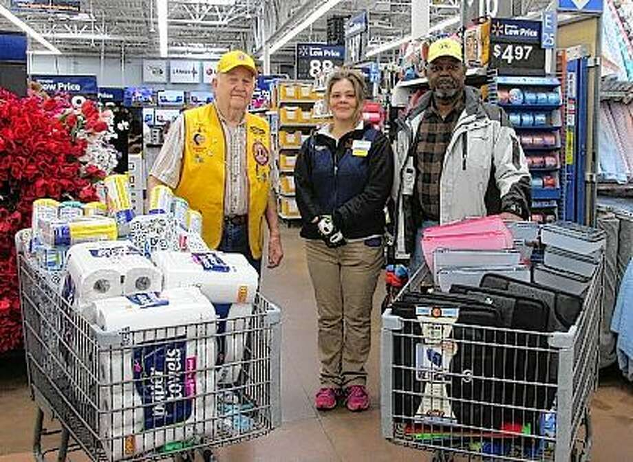Jacksonville Lions Club President Jimmie Barber (left) received a call from School District 117 and was given a list of school supplies that were needed. Barber with the assistance of Lion Vice President Aaron Singleton (right) and Walmart Department manager Jeaneen Dumdie (center) helped gather the supplies. The Lions thank Walmart and the people of Jacksonville and the surrounding communities for their generous donations during the club's school supply fundraiser. Photo: Submitted Photo