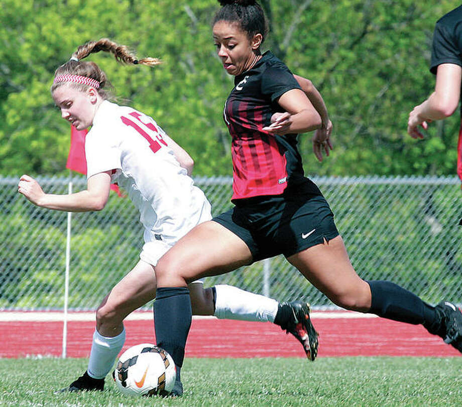 Alton's Katie Kercher, left, and her teammates finished the season 12-6-2. Above, Kercher battles with Granite City's Maya Ware during a May 6 game at AHS. Photo: James B. Ritter | For The Telegraph