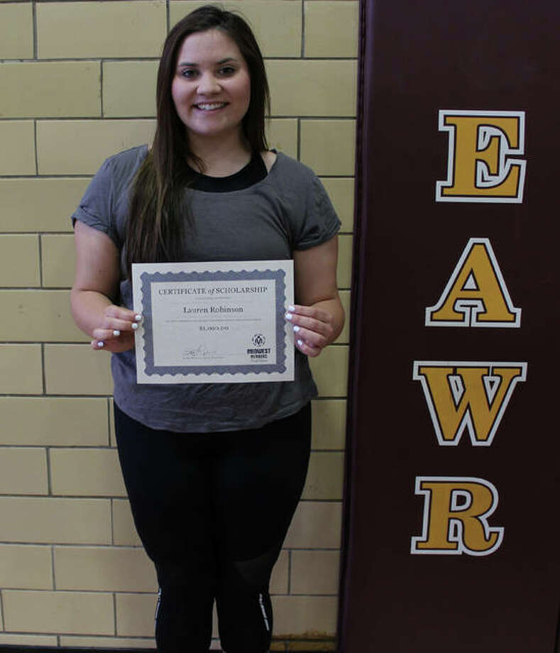 Lauren Robinson with the scholarship presented to her by Midwest Members Credit Union at East Alton-Wood River High School's recent awards ceremony. Photo: For The Telegraph