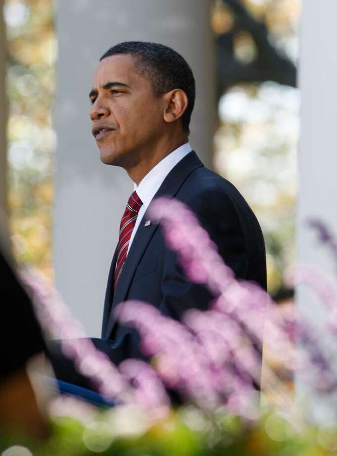 President Barack Obama speaks in the Rose Garden of the White House about health care reform and Iraq's new electoral law after returning from Camp David Sunday, Nov. 8, 2009, in Washington. (Ron Edmonds / Associated Press) Photo: Ron Edmonds / FR170127 AP
