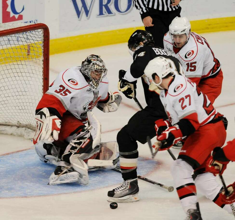 River Rats goalie Justin Peters, No. 35, loses his stick as Wilkes-Barre/Scranton Penguins right wing Aaron Boogaard, No. 34, works the crease. Rats defenseman Jonathan Paiement, No. 27, and Rats center Stefan Chaput, No. 15, try to clear the puck in front of the River Rats goal on Sunday, Dec. 6, 2009, at Times Union Center. (Luanne M. Ferris / Times Union)