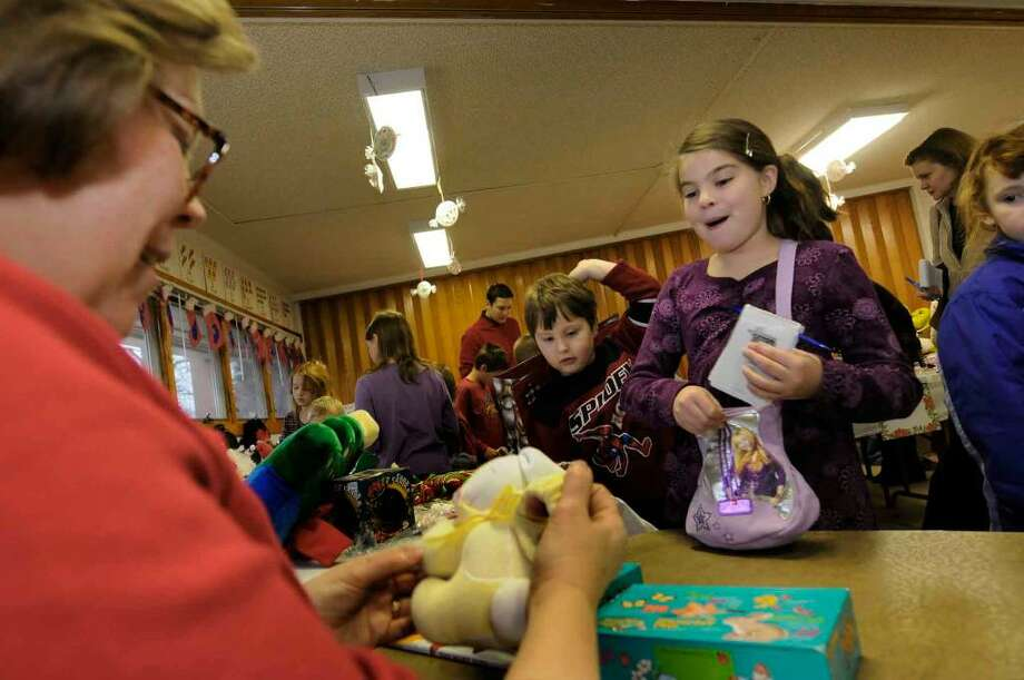Ten-year-old Danielle Wilkins gets her purchases wraped during the annual Santa's Workshop at the Church of the Covenant in Averill Park ,New York 12/05/2009. (Michael P. Farrell/Albany Times Union) Photo: MICHAEL P. FARRELL