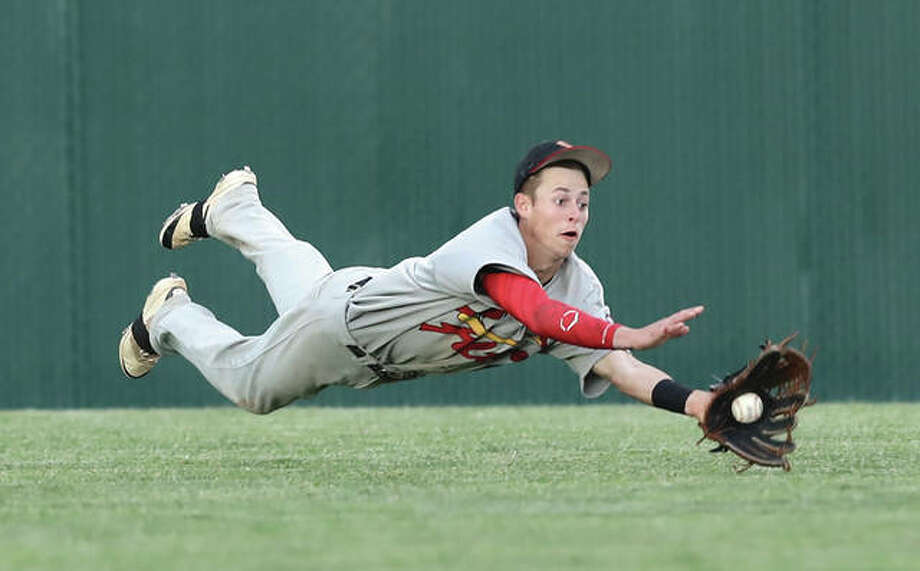 Alton center fielder Michael Hampton makes a diving catch to rob the Tigers of a hit during a semifinal baseball game in the Edwardsville Class 4A Regional on Wednesday night at Tom Pile Field in Edwardsville. Photo: Billy Hurst / For The Telegraph