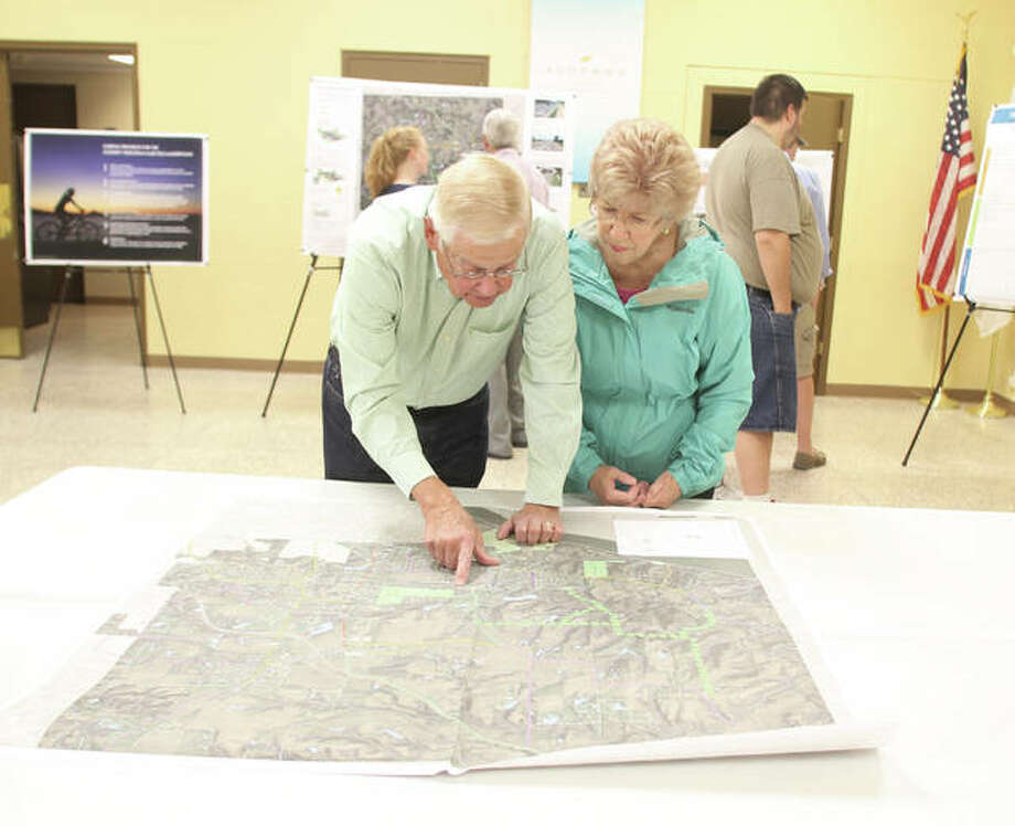 Darv and Delores Bloemker look over a map of potential bike/pedestrian routes and improvements Wednesday at an open house on the village of Godfrey's draft bike/walking trail plan. About 25 people attended the open house, one of the last steps before the plan is completed and presented to the village. Photo: Scott Cousins/The Telegraph