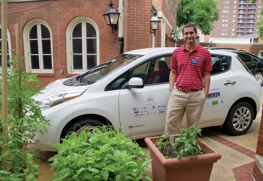 L&C Director of Sustainability Nate Keener is shown participating in the 2014 Illinois Green Economy Network's EV Road Trip. The reduction of vehicle emissions is one of a number of initiatives Lewis and Clark is tackling on its way to carbon neutrality in 2058.