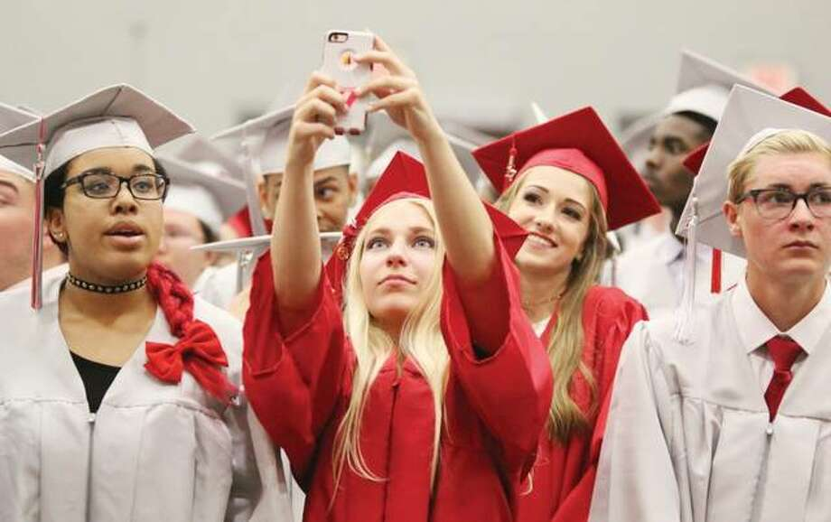 Graduating Alton High School senior Jayne Louise Allen takes a selfie early in the 148th commencement exercises at Alton High School Friday evening. She was among 458 students graduating with the Class of 2017.