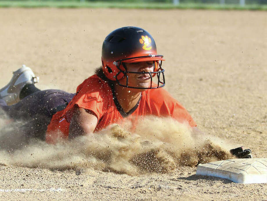 Edwardsville's Maria Smith slides in safely as she steals third base during a Southwestern Conference game against the Alton Redbirds in Godfrey. Smith was a varsity performer in three sports as a freshman at Edwardsville. Photo: Billy Hurst / For The Telegraph