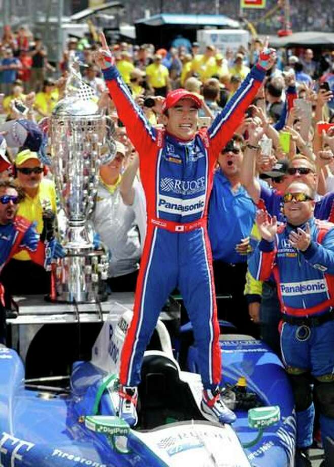 Takuma Sato, of Japan, celebrates after winning the Indianapolis 500 Sunday in Indianapolis. Photo: Darron Cummings | AP