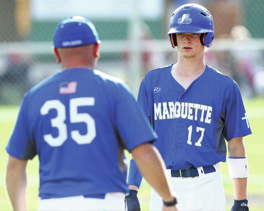 Marquette's Brady McAfee (right) talks with Explorers coach Tim Fahnestock during a game May 8 in Carrollton. Marquette finished 22-11 and won its first regional championship since 2012. Photo: Billy Hurst / For The Telegraph
