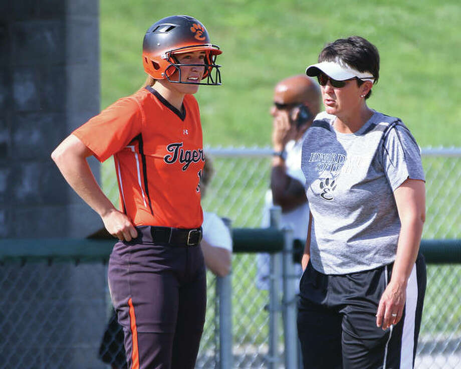 Edwardsville coach Lori Blade (right) talks with senior Sarah Hangsleben during the Tigers' SWC victory over Alton on May 18 at AHS in Godfrey. The Tigers finished 29-5 with Hangsleben leading the team in hitting before heading off to play college softball at Villanova. Photo: Billy Hurst / For The Telegraph