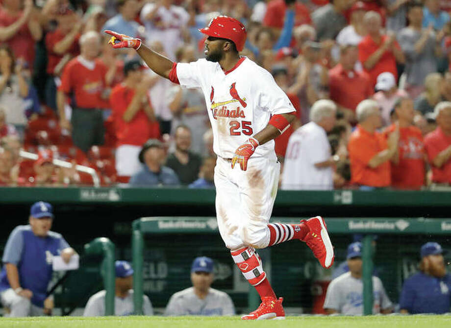 The Cardinals' Dexter Fowler celebrates as he rounds the bases after hitting a solo home run in the eighth inning of a Wednesday night's 2-1 win over the Los Angeles Dodgers at Busch Stadium. Photo: AP