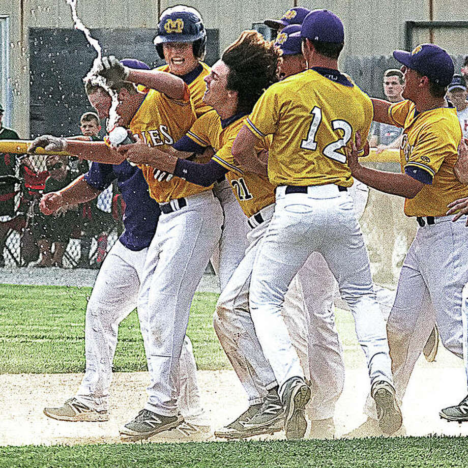 CM players celebrate a walk-off hit by Jaxsen Helmkamp, left, that lifted the Eagles past Mount Vernon 4-3 in nine innings Wednesday night in the semifinals of the Salem 3A Sectional.