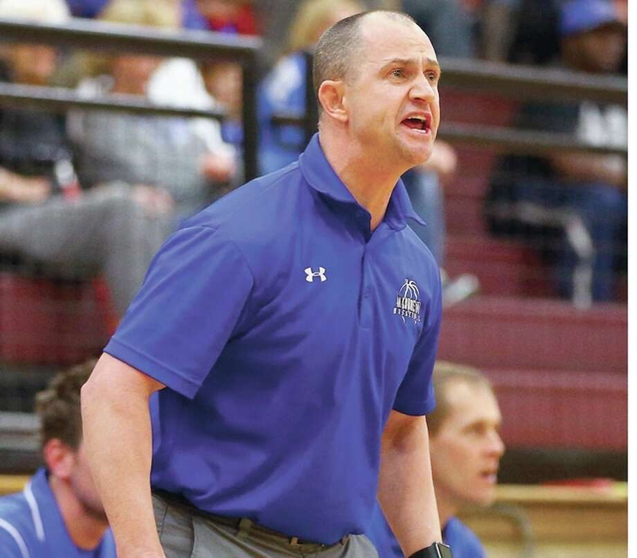Marquette's head coach Steve Medford's team dropped a 38-34 decision to Breese Central in the semifinals of the Pinckneyville Class 2A Sectioanl Tuesday. Photo: Billy Hurst | For The Telegraph